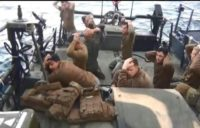 The US Navy said Commander Eric Rasch, who commanded the sailors briefly captured by Iran in January (pictured), had been relieved of command and reassigned