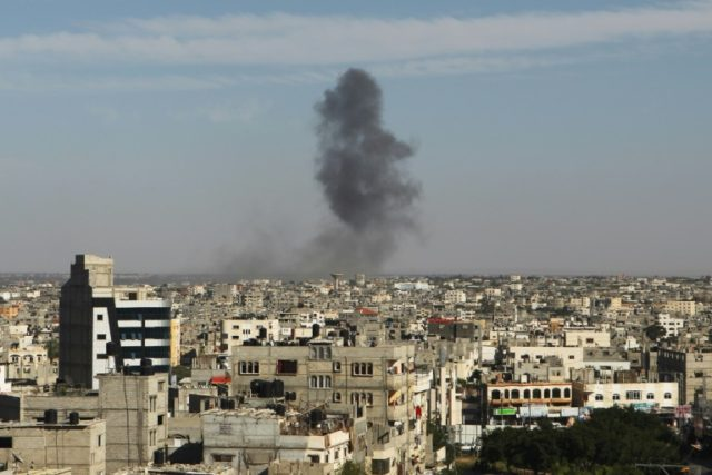 Smoke rises following an Israeli air strike in Rafah, in the southern Gaza Strip