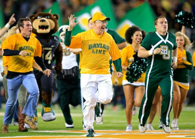 Ken Starr, pictured on December 6, 2014, was stripped of his post as president of Baylor University in Texas but will stay on as chancellor, the school's Board of Regents said