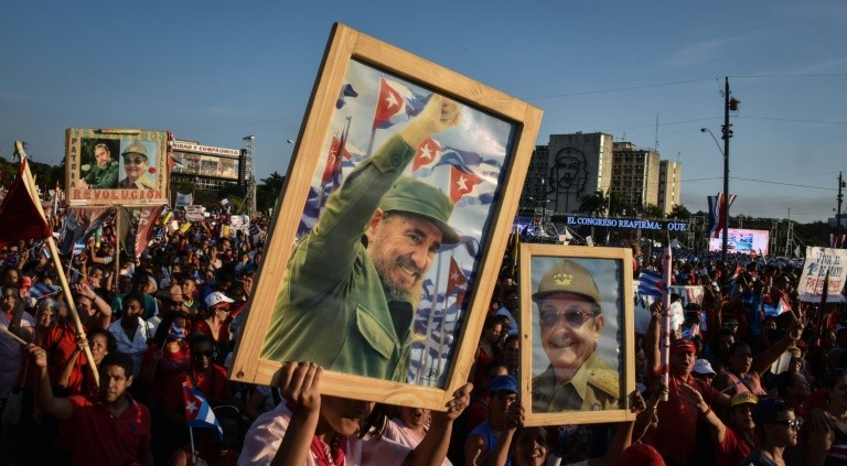 Cubans display pictures of their former leader Fidel Castro and their current president Raul Castro, during the May Day parade in Havana, on May 1, 2016