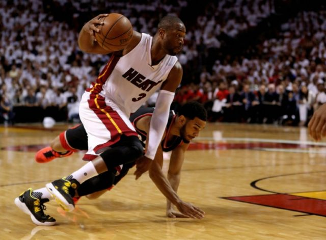 Dwyane Wade (L) scores 30 points as the Miami Heat even their second-round playoff series with a 94-87 win over Toronto