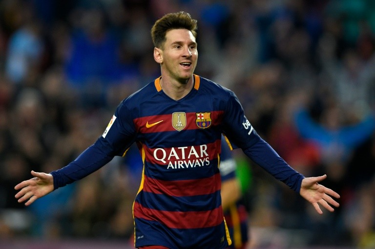 Barcelona's forward Lionel Messi celebrates after scoring a goal during the Spanish league football match FC Barcelona vs Real Sporting de Gijón at the Camp Nou stadium in Barcelona on April 23, 2016