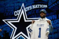 Ezekiel Elliott of Ohio State holds up a jersey after being picked #4 overall by the Dallas Cowboys during the first round of the 2016 NFL Draft on April 28, 2016 in Chicago, Illinois
