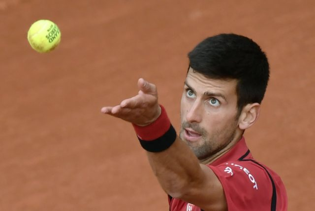 Serbia's Novak Djokovic serves the ball to Taiwan's Lu Yen-Hsun during their first round match at the French Open in Paris, on May 24, 2016
