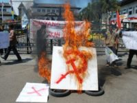 An anti-communism group holds a rally in Bandung, West Java province, Indonesia