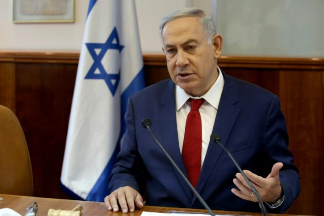 Israeli Prime Minister Benjamin Netanyahu opens the weekly cabinet meeting on May 15, 2016 at his Jerusalem office