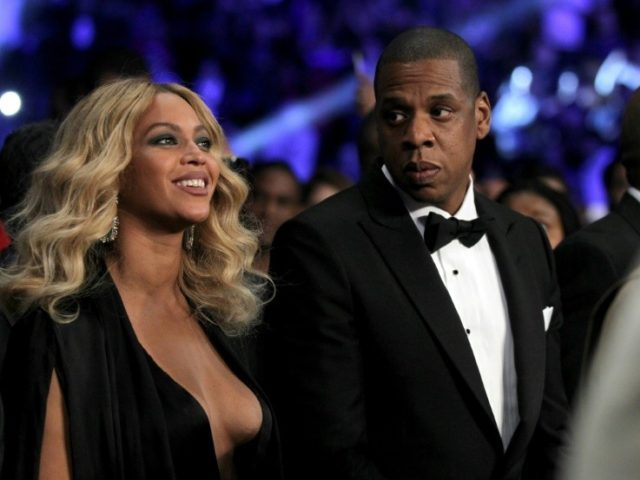 Beyonce Knowles (L) and Jay-Z, pictured on November 21, 2015