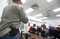 A gun instructor teaches a class to obtain a concealed gun carry permit