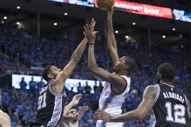 Kevin Durant of the Oklahoma City Thunder shoots over Tim Duncan of the San Antonio Spurs during Game Six of the Western Conference Semifinals