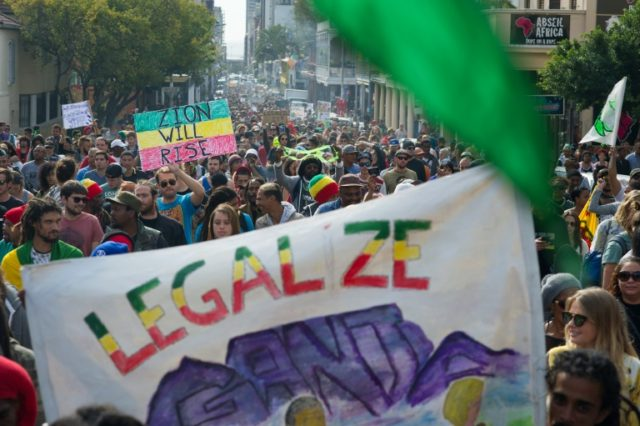 Thousands of people take part in a march through Cape Town, calling for the South African government to legalise marijuana, on May 7, 2016