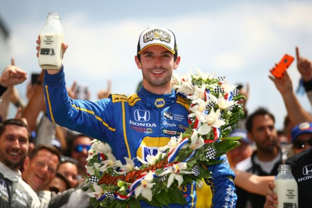Alexander Rossi, driver of the #98 NAPA Auto Parts Andretti Herta Autosport Honda, celebrates after winning the 100th running of the Indianapolis 500 on May 29, 2016