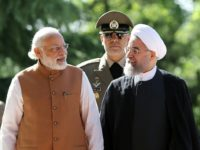 Iranian President Hassan Rouhani on May 23, 2016 shows him (right) walks alongside Indian Prime Minister Narendra Modi during a welcome ceremony in Tehran on May 23, 2016