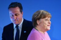 British Prime Minister David Cameron (L) and German Chancellor Angela Merkel, at a donor conference for Syria in London in February