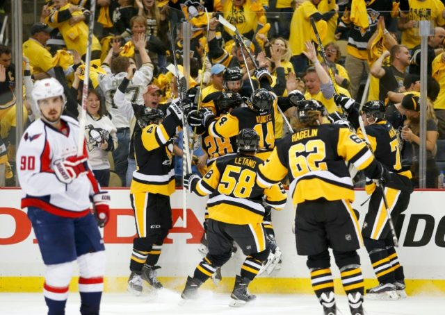 The Pittsburgh Penguins players celebrate the game winning OT goal by Nick Bonino against the Washington Capitals, in Game Six of their Eastern Conference NHL playoff semi-finals, at Consol Energy Center in Pittsburgh, Pennsylvania, on May 10, 2016