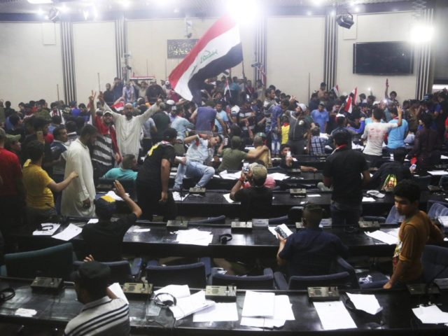 Protesters Storm Iraq's Parliament, Take Selfies in Legislator Seats