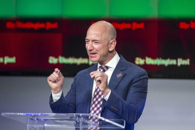 FILE - In this Jan. 28, 2016, file photo, billionaire Amazon founder and Washington Post owner Jeff Bezos talks about the history and character of the Post during a dedication ceremony for its new headquarters in Washington. Presumptive Republican presidential nominee Donald Trump told Fox News in an interview on May 12, 2016, that Bezos was using the Post to help Amazon avoid taxes. (AP Photo/J. Scott Applewhite, File)