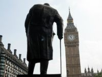 A statue of former British Prime Minster Winston Churchill faces the Houses of Parliament as the Great Clock strikes 11am, exactly 75 years after Britain's declaration of war against Germany and her involvement in World War II, on September 3, 2014 in London, England.