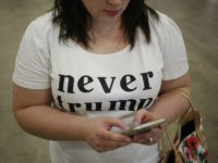 An attendee wears a 'Never Trump' shirt during a campaign event for Donald Trump, president and chief executive of Trump Organization Inc. and 2016 Republican presidential candidate, not pictured, in Indianapolis, Indiana, U.S., on Wednesday, April 20, 2016. Trump and Hillary Clinton won their New York presidential primaries Tuesday, ending …
