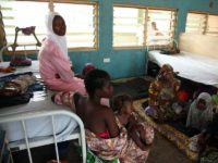 NIGERIA, Yola : Women and children rescued by Nigerian soldiers from Islamist militants Boko Haram at Sambisa Forest wait to receive treatment at the Federal Medical Centre in Yola on May 5, 2015. They were among a group of 275 people rescued by the Nigerian military last week and arrived …