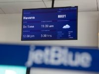 A direct flight to Havana, Cuba, is listed on a screen in JetBlue Airways Corp.'s Terminal 5 at John F. Kennedy International Airport (JFK) airport in New York, U.S., on Friday, Aug. 7, 2015. The largest airline at JFK by passengers, JetBlue will be building a 505-room, $250 million TWA …