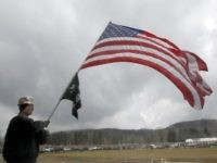 Dave Thearle, a member of the United Mine Workers of America, waves an American Flag during a labor rally in Waynesburg, Pa., Friday, April 1, 2011. Thousands of union coal miners and supporters from several states tried to spark an uprising in southwestern Pennsylvania on Friday, proclaiming themselves ready to mobilize for the war they say is being waged on organized labor in the United States. (AP Photo/Keith Srakocic)