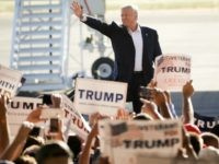 Republican presidential candidate Donald Trump waves to the crowd as he arrives to speak at a rally Wednesday, June 1, 2016, in Sacramento, Calif. (
