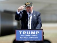 "Donald Trump, the presumptive Republican presidential nominee gestures to a his camouflaged ""Make America Great"" hat as he discuses his support by the National Rifle Association at a campaign rally at the Redding Municipal Airport Friday, June 3, 2016, in Redding, Calif. (AP Photo/Rich Pedroncelli)"