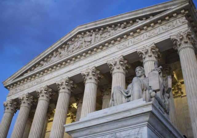 FILE - In this Feb. 13, 2016 file photo, the Supreme Court building is seen Washington. The Supreme Court will hear appeals from two African-American death-row inmates in Texas, including one who argued his sentence was based on his race. (AP Photo/Jon Elswick, File)