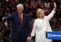 Former President Bill Clinton, left, stands on stage with his wife, Democratic presidential candidate Hillary Clinton, after she spoke during a presidential primary election night rally, Tuesday, June 7, 2016, in New York. (AP Photo/Julio Cortez)