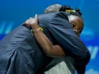 Barack Obama hugs Mikaila Ulmer after being introduced at the White House Summit on the United State of Woman, Tuesday, June 14, 2016 in Washington. The White House hosted the event to mark the progress made by and for women and girls domestically and internationally over the course of Obama's administration and to discuss solutions to the challenges they still face. (