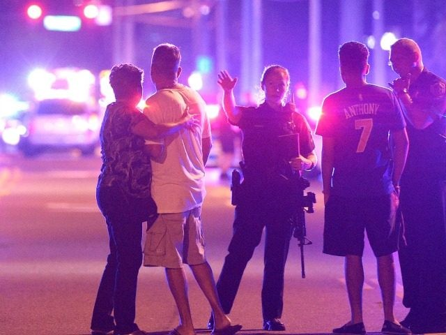 Orlando Police officers direct family members away from a fatal shooting at Pulse Orlando nightclub in Orlando, Fla. June 12, 2016.