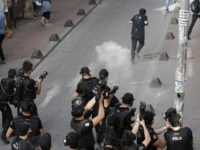 Turkish police officers fire tear gas and rubber bullets to disperse demonstrators who gathered for a gay pride rally despite a government ban, off Istiklal Avenue, central Istanbul's main shopping road, Sunday, June 19, 2016. Istanbul's governor had banned gay, lesbian and transgender individuals from holding two annual parades this …