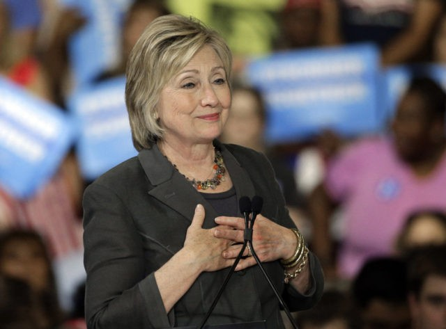 """Democratic presidential candidate Hillary Clinton gestures as she """"sighs"""" talking about Republican presidential candidate Donald Trump during a rally in Raleigh, N.C., Wednesday, June 22, 2016. (AP Photo/Chuck Burton)"""