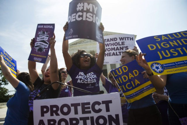 Pro-choice activists celebrate during a rally at the Supreme Court in Washington, Monday, June 27, 2016, after the court struck down Texas' widely replicated regulation of abortion clinics. The justices voted 5-3 in favor of Texas clinics that had argued the regulations were a thinly veiled attempt to make it …