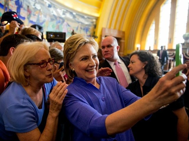 Democratic presidential candidate Hillary Clinton takes a photo with a member of the audience following a rally at the Cincinnati Museum Center at Union Terminal in Cincinnati, Monday, June 27, 2016. (AP Photo/Andrew Harnik)