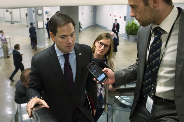 Sen. Marco Rubio of Fla. speaks with reporters while he walks through the Capitol in Washington, Tuesday, June 28, 2016. (AP Photo/Cliff Owen)