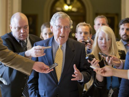 FILE -In this file July 15, 2013 file photo, Senate Republican Leader Mitch McConnell of Ky. is surrounded by reporters on Capitol Hill in Washington. McConnell faces a nearly impossible task this election year: protecting Senate Republicans from the political upheaval of Donald Trump's presidential campaign. Trump's polar opposite in …