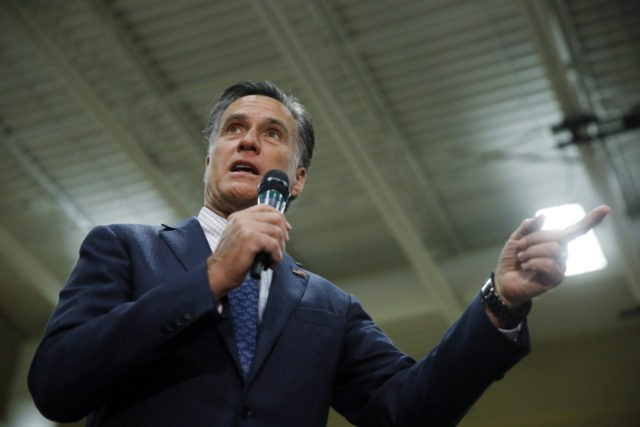 Former Republican presidential candidate Mitt Romney speaks at a Republican presidential candidate, Ohio Gov. John Kasich campaign stop on Monday, March 14, 2016, at Westerville Central High School in Westerville, Ohio. (AP Photo/Matt Rourke)