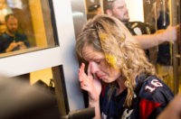 A woman wipes egg off her face after being pursued by protesters while leaving Republican presidential candidate Donald Trump's campaign rally on Thursday, June 2, 2016, in San Jose, Calif. A group of protesters attacked Trump supporters who were leaving the presidential candidate's rally in San Jose on Thursday night. A dozen or more people were punched, at least one person was pelted with an egg and Trump hats grabbed from supporters were set on fire on the ground.  (AP Photo/Noah Berger)