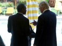 Former Republican presidential candidate Ben Carson, left, speaks with Republican presidential candidate Donald Trump after a news conference at the Mar-A-Lago Club, Friday, March 11, 2016, in Palm Beach, Fla.