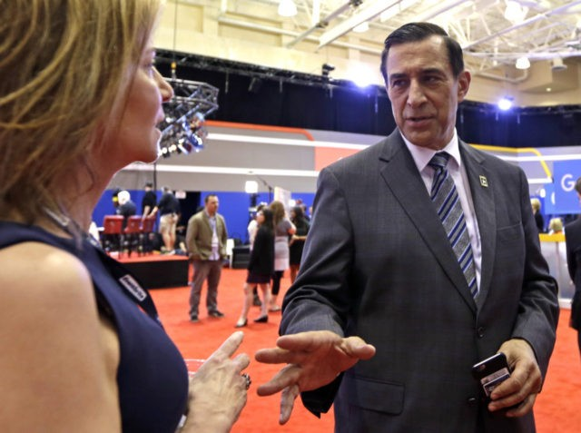 Rep. Darrell Issa, R-Calif., talks to a reporter in the media filing room before the Republican presidential debate sponsored by CNN, Salem Media Group and the Washington Times at the University of Miami, Thursday, March 10, 2016, in Coral Gables, Fla. (AP Photo/Alan Diaz)