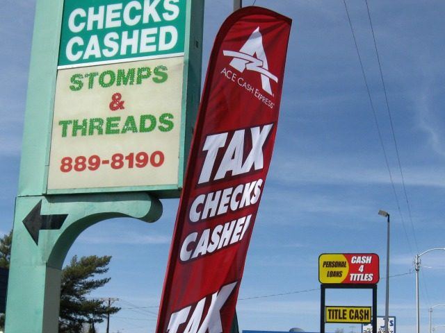 In this April 3, 2015 photo, an ACE Cash Express outlet is seen on San Mateo Boulevard in Albuquerque, N.M.