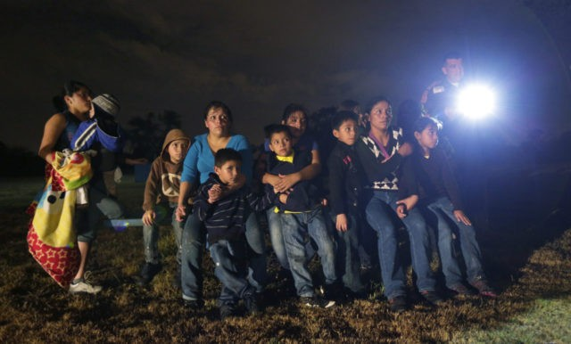 FILE - This June 25, 2014 file photo, shows a group of immigrants from Honduras and El Salvador who crossed the U.S.-Mexico border illegally as they are stopped in Granjeno, Texas. Illegal crossings along the Rio Grande have slowed dramatically since an overwhelming surge of immigrants had state and federal …