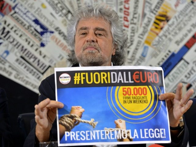Five Stars movement's leader Beppe Grillo shows a paper reading 'Out of the Euro - 50.000 signatures in a week-end' during a press conference on December 18, 2014 in Rome.