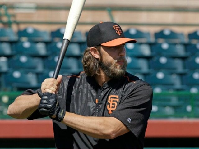 San Francisco Giants' Madison Bumgarner waits to bat during batting practice prior to a spring training exhibition baseball game against the Los Angeles Angels, Sunday, March 22, 2015, in Scottsdale, Ariz. (AP Photo/Ben Margot)