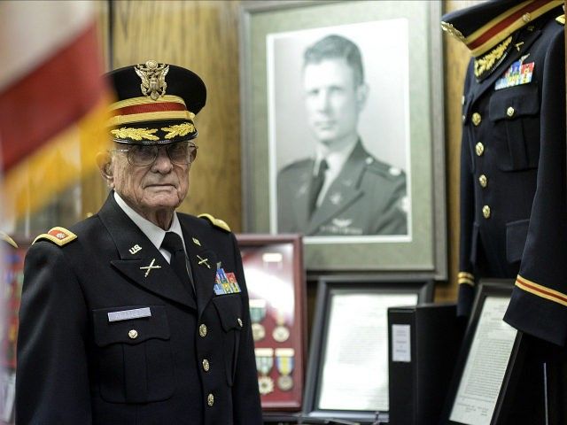 In this photo taken Oct. 25, 2015, Charles Kettles poses for a photo at the Ypsilanti Historical Museum in Ypsilanti, Mich. Kettles, a Vietnam War helicopter pilot, will receive the Medal of Honor from President Barack Obama at a White House ceremony on July 18, for saving the lives of dozens of troops. (Junfu Han/The Ann Arbor News via AP) LOCAL TELEVISION OUT; LOCAL INTERNET OUT; MANDATORY CREDIT