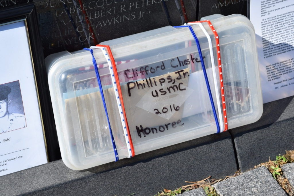 Personal memorabilia placed by loved ones at Vietnam War Memorial. (Bob Price/Breitbart Texas)