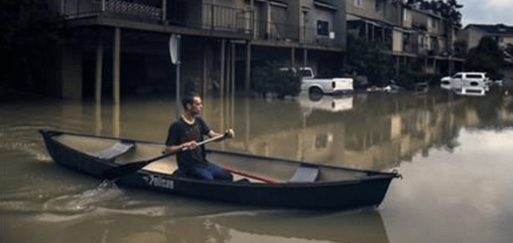 Chance Morgan canoes past flooded townhouses in the Forest Cove neighborhood as he tries to get to his home Thursday, June 2, 2016 near Kingwood, Texas. Parts of Texas have been inundated with rain in the last week, and more than half of the state is under flood watches or warnings, including the counties near Fort Hood. At least six people died in floods last week in Central and Southeast Texas. (Michael Ciaglo/Houston Chronicle via AP)