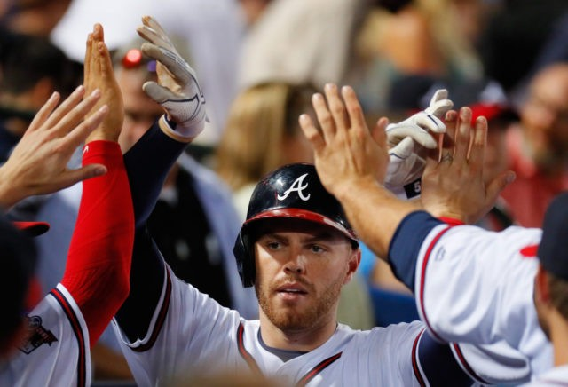 ATLANTA, GA - JUNE 15: Freddie Freeman #5 of the Atlanta Braves reacts after hitting a solo homer in the sixth inning against the Cincinnati Reds at Turner Field on June 15, 2016 in Atlanta, Georgia. (Photo by Kevin C. Cox/Getty Images)