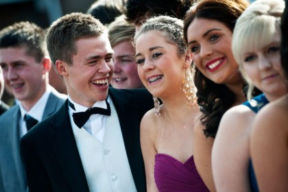 NEWCASTLE, UNITED KINGDOM - JULY 01: Matthew Rayner and Erin Bowmaker pose for pictures with school friends before catching the bus to the school prom on July 1, 2011 in Newcastle, United Kingdom. After months of preparation more than 200 final year students aged 15 to 16 from Cramlington Learning …